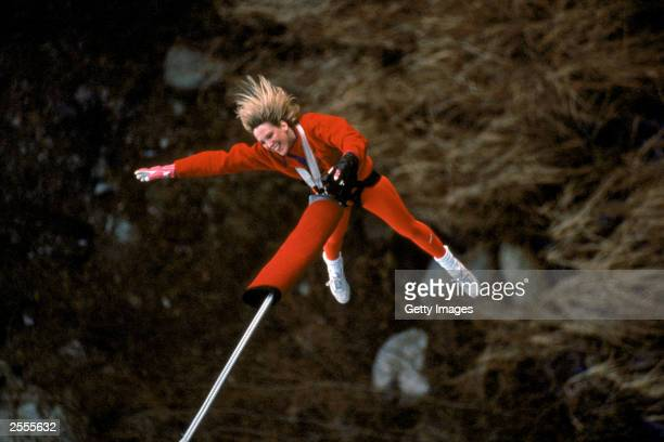 Competitor in the bungee jumping event celebrates a successful jump