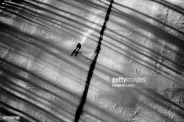 A competitor in the Men's Alpine Skiing Super Combined Downhill at the Rosa Khutor Alpine Center during the Sochi Winter Olympics on February 14 2014