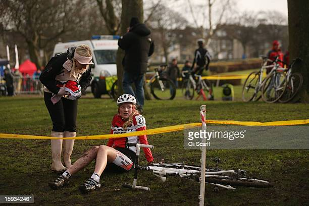 A competitor in the 'Youth Under 14' category rests after taking part the 2013 National CycloCross Championships in Peel Park on January 12 2013 in...