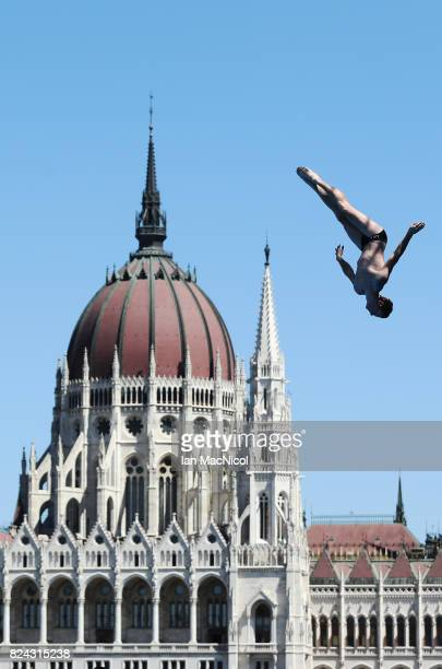 A competitor is seen during practice at the high diving event during the FINA World Championships at Batthyanyi Square on the river Danube during day...