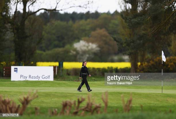 A competitor is seen on the 1st green during the second round of the Girls' U16 Open Championship at Fulford Golf Club on April 28 2018 in York...