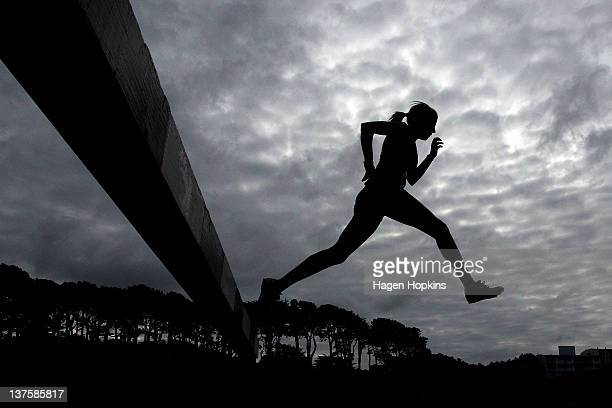 Competitor jumps in the women's 3000m steeplechase during the Capital Classic at Newtown Park on January 23, 2012 in Wellington, New Zealand.