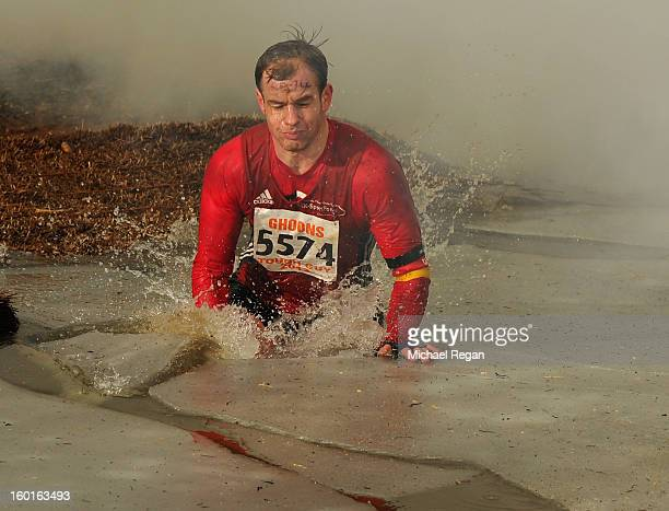A competitor jumps into icy water during the Tough Guy Challenge endurance race on January 27 2013 in Telford England Every year thousands of people...