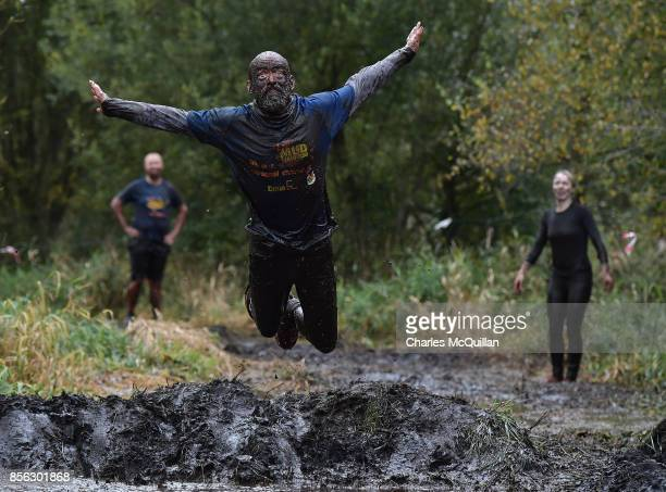 A competitor jumps into the mud pit during the McVities Jaffa Cakes Mud Madness race in association with charity partner Marie Curie at Foymore Lodge...