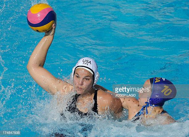 US competitor Kameryn Craig is held back by Brazil's Flavia Vigna during the preliminary rounds of the women's water polo at the FINA World...