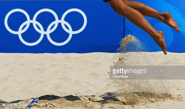 A competitor kicks up sand as he serves during beach volleyball practice ahead of the Beijing 2008 Olympic Games on August 2 2008 in Beijing China