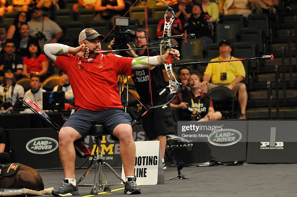 Competitor Luc Martin (CAN) shoots during the Archery Finals at the Invictus Games at ESPN Wide World of Sports complex on May 9, 2016 in Lake Buena Vista, Florida.