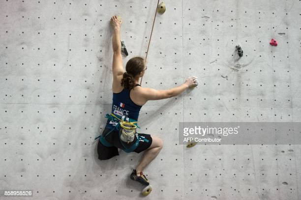 Competitor Lucie Jarrige of France takes part in the English stage of the IFSC Paraclimbing Cup at the Awesome Walls climbing centre in Sheffield...
