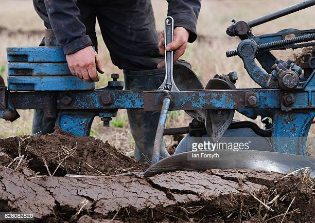 Competitor makes adjustments to his plough as he takes part in the annual ploughing match on November 27, 2016 in Staithes, United Kingdom. The event...