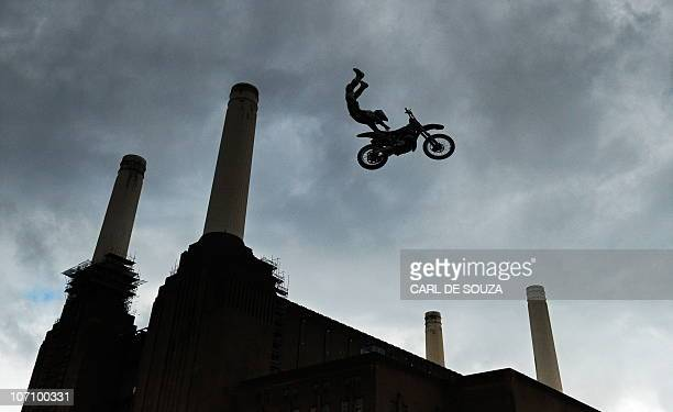 US competitor Mike Mason takes part in a practice session of the Red Bull XFighters motocross championships in front of London's iconic Battersea...