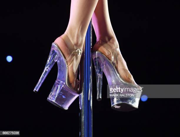 A competitor performs during the 2017 Pacific Pole Championships at the Convention Center in Los Angeles California on April 8 2017 Combining dance...