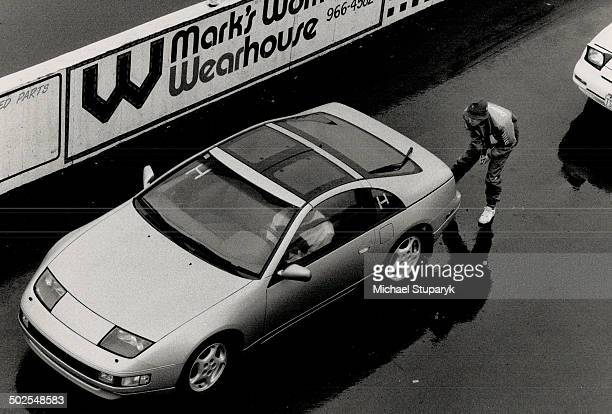 Competitor Peter Shaw chooses his mount a '90 Nissan 300ZX while instructor helps another adjust mirrors