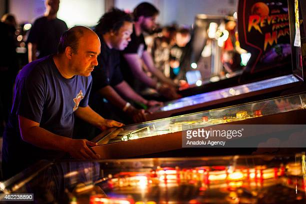 A competitor plays in a pinball tournament at MAGfest 13 in National Harbor Md on January 24 2015 MAGfest is an annual convention held in the...