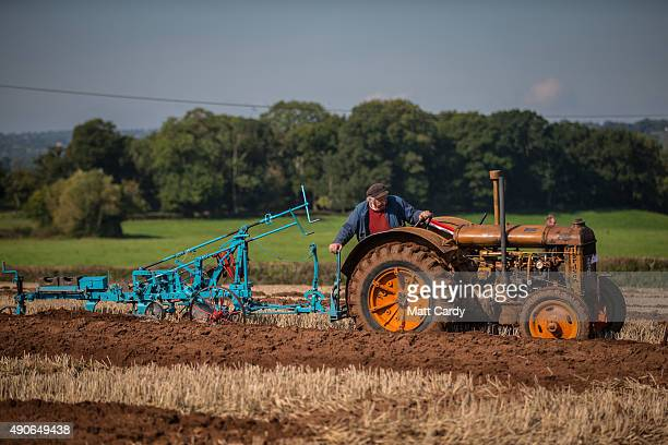 A competitor ploughs a field using a vintage tractor as he takes part in the Mendip Ploughing Society's 146th annual competitions at Stanton Wick...