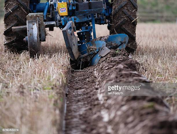 Competitor ploughs a furrow as he takes part in the annual ploughing match on November 27, 2016 in Staithes, United Kingdom. The event which is held...