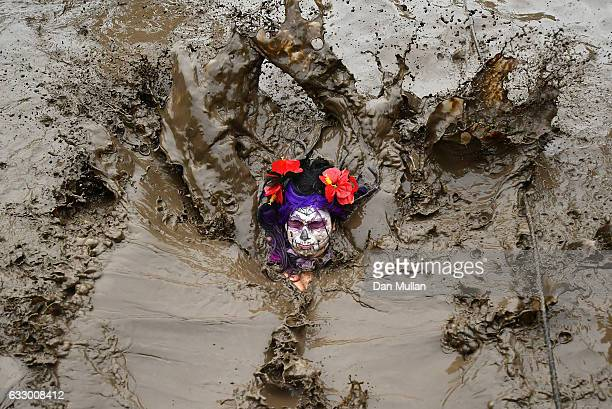 A competitor plunges into the mud during the Tough Guy Challenge at South Perton Farm on January 29 2017 in Telford England
