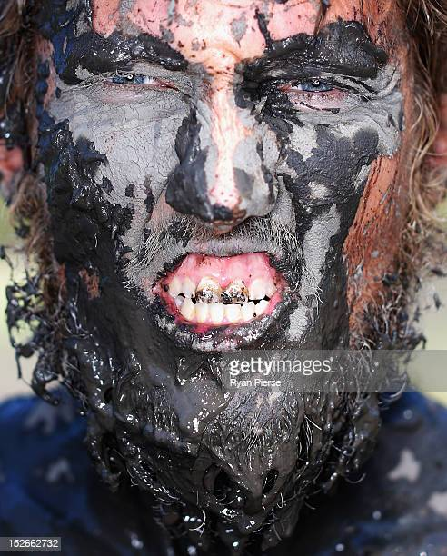 A competitor poses during 2012 Tough Mudder at Glenworth Valley on September 23 2012 in Sydney Australia