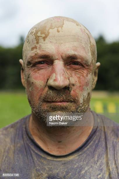 Competitor poses for a photograph during the 2017 Tough Mudder South West at Badminton Estate on August 20 2017 in Cirencester England