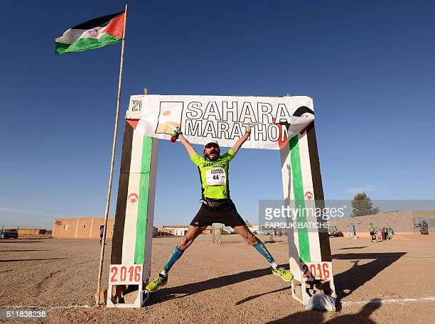 A competitor poses for a picture before taking the start of the 16th Sahara Marathon on February 23 2016 in the Algerian ElAioun Saharawi refugee...
