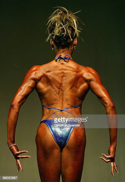 A competitor poses for judges during the womens open bodybuilding divison during the Australian Bodybuilding and Bodyshaping Championships at Revesby...