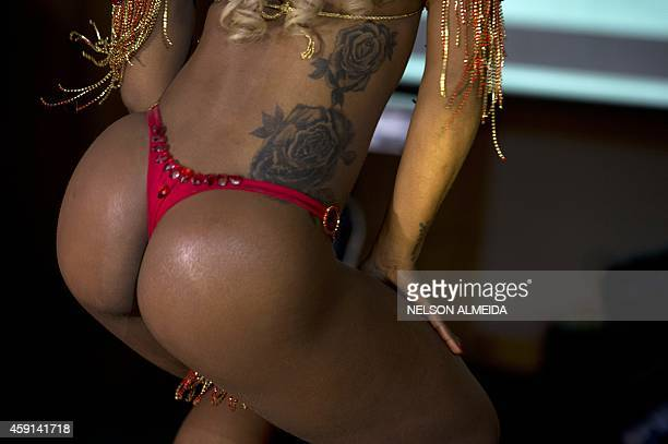 A competitor poses on the catwalk during the Miss Bumbum Brazil 2014 pageant in Sao Paulo on November 17 2014 Fifteen candidates compete in the...