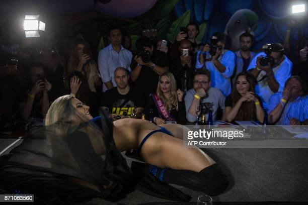 A competitor poses on the catwalk during the Miss Bumbum Brazil 2017 pageant in Sao Paulo on November 07 2017 Fifteen candidates are competing in the...