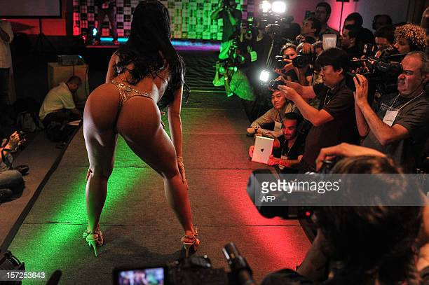 A competitor poses on the catwalk during the Miss Bumbum pageant in Sao Paulo on November 30 2012 All eyes are on Brazil's annual Miss Bumbum pageant...