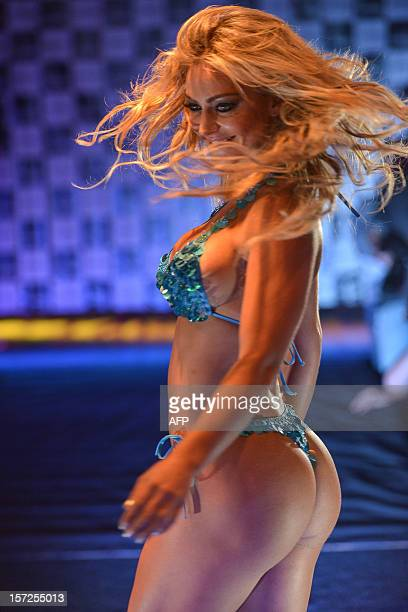 Competitor poses on the catwalk during the Miss Bumbum pageant in Sao Paulo on November 30, 2012. All eyes are on Brazil's annual Miss Bumbum pageant...
