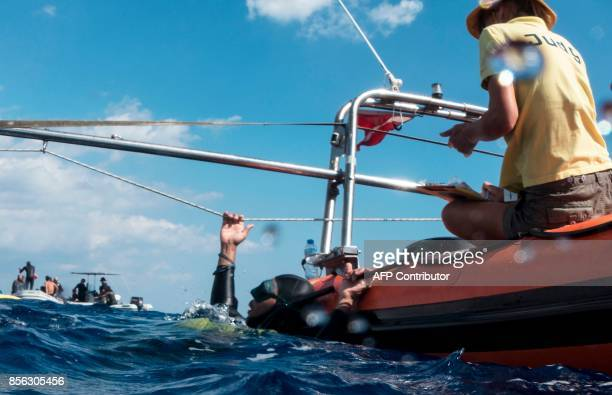 A competitor practices breathing exercises prior to competing in a freediving competition off the coast of Salamis in the selfproclaimed Turkish...