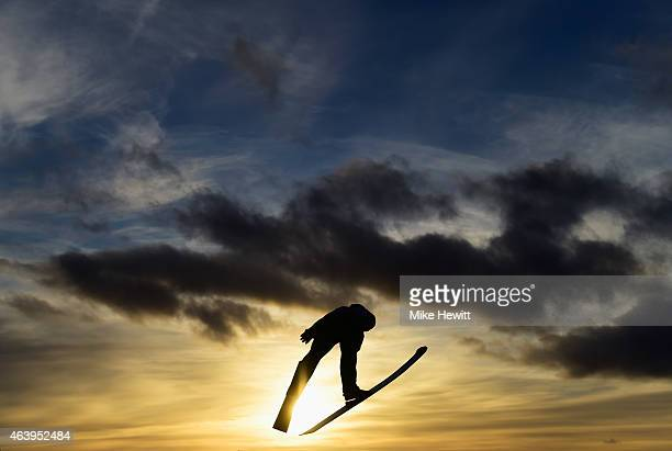 A competitor practices during the Women's HS100 Normal Hill Ski Jumping trial during the FIS Nordic World Ski Championships at the Lugnet venue on...