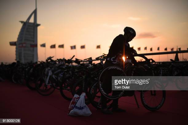 A competitor prepares his bicycle prior to the Ironman 703 Dubai 2018 on February 1 2018 in Dubai United Arab Emirates