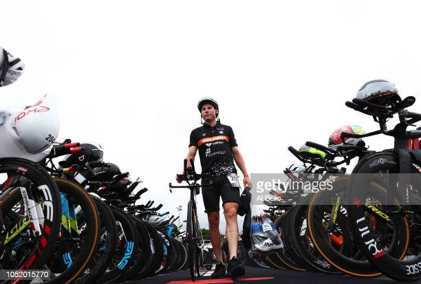 A competitor prepares their bike in the transition area during the preparation for the Ironman World Championships on October 12 2018 in Kailua Kona...