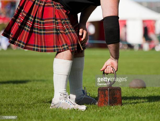 "competitor preparing to throw at ""weight over the bar"" - kilt stock photos and pictures"