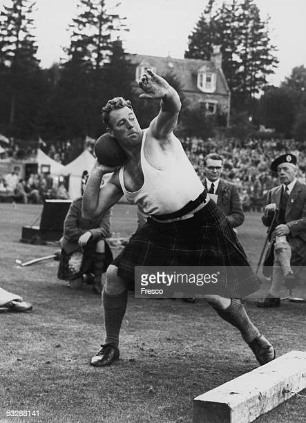 A competitor putting the heavy stone at the annual Braemar Gathering September 1955