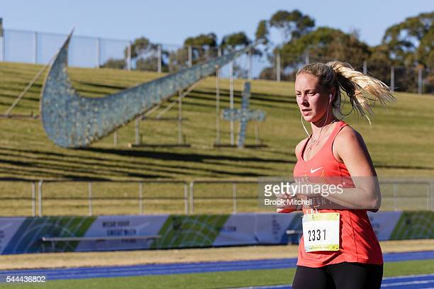 A competitor races to the finish of the Nike Women's Half Marathon at Sydney Olympic Park on July 3 2016 in Sydney Australia