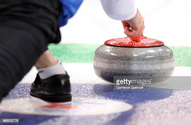 A competitor releases his stone during the men's curling round robin game between Germany and the United States on day 5 of the Vancouver 2010 Winter...