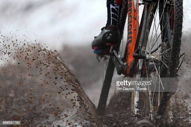 A competitor rides through mud and water during the Elm City CX CT Series Cyclocross Competition on December 18th 2016 at the Edgewood Park New Haven...
