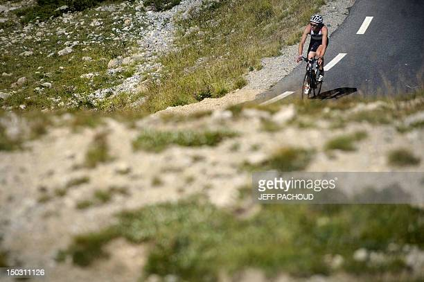 A competitor rides to the top of the Col d'Izoard on August 15 2009 in Embrun southeastern France during the 26th Embrunman triathlon The Embrunman...