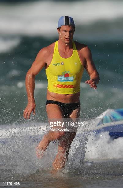 Competitor runs exits the water in the Open Men's Ironman during the 2011 Australian Surf Lifesaving Championships at Kurrawa Beach on April 7 2011...