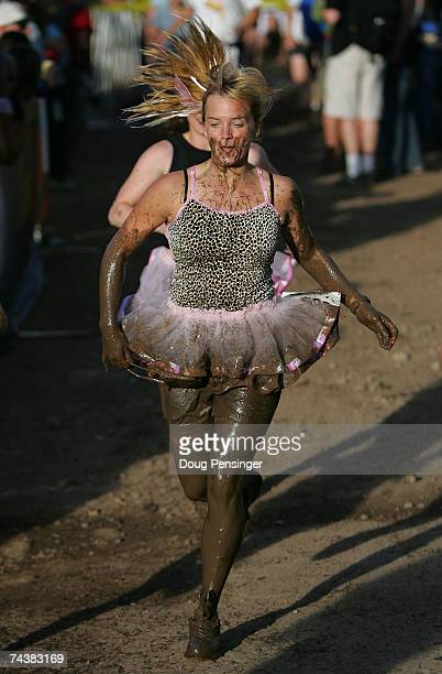 A competitor runs from the mud obstacle during the Teva X1 5K Mud Fun Run at the Teva Mountain Games on June 2 2007 in Vail Colorado