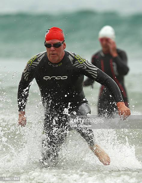 A competitor runs out of the water during the 2012 Pier to Pub on January 7 2012 in Lorne Australia