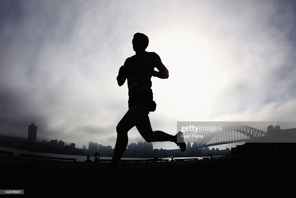 A competitor runs past the Sydney Harbour Bridge during the 2012 Men's Health Urbanathlon on April 22, 2012 in Sydney, Australia.