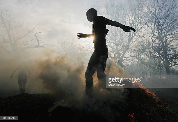 A competitor runs through fire during the Tough Guy Challenge on January 28 2007 near Wolverhampton England