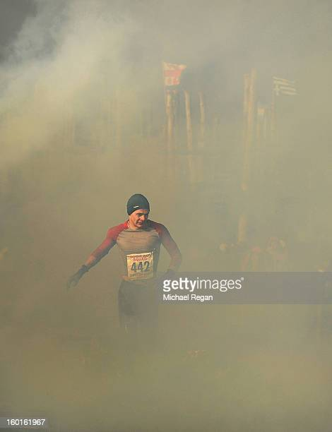 A competitor runs through smoke during the Tough Guy Challenge endurance race on January 27 2013 in Telford England Every year thousands of people...