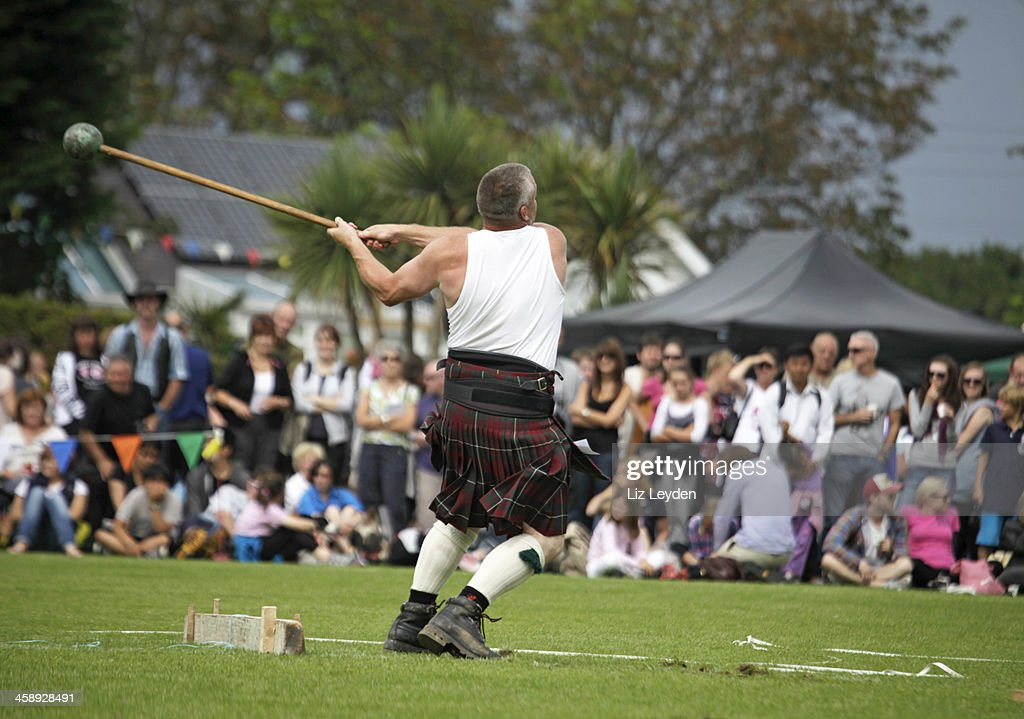 Competitor: Scots Hammer competition, Brodick Highland Games : Stock Photo