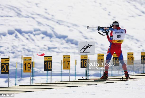 A competitor shoots during the Mens 20 Km individual race at The EOn Ruhgas IBU Biathlon World Cup on Feburary 9 2005 in Cesana San Sicario Italy