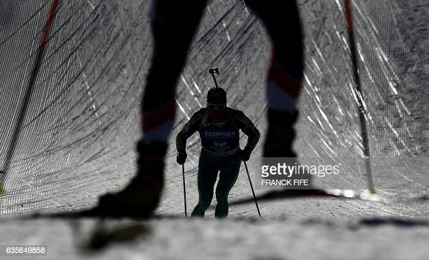 Competitor skies during the Men 20 km Individual event at the FIS Biathlon World Championships in Hochfilzen on February 16, 2017. / AFP / FRANCK FIFE