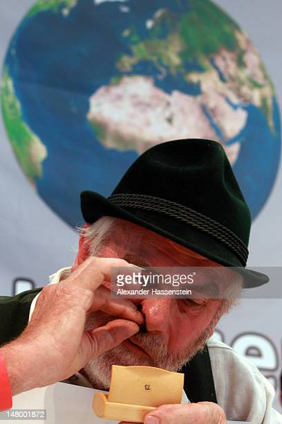 Competitor snuff during 18th Snuff World Championships on July 7 2012 in Peutenhausen near Munich Germany 290 participants from Germany Austria the...