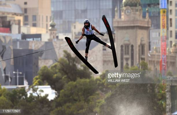 Competitor soars over the Melbourne skyline during the Moomba Masters ski jump event on the Yarra river on March 11, 2019. / --IMAGE RESTRICTED TO...