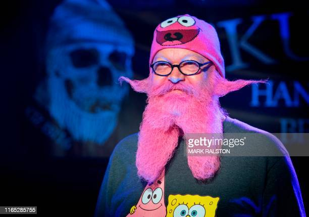 A competitor stands on stage in the annual Beard and Mustache Battle to raise money for charity at the Resident Bar in Los Angeles California on...